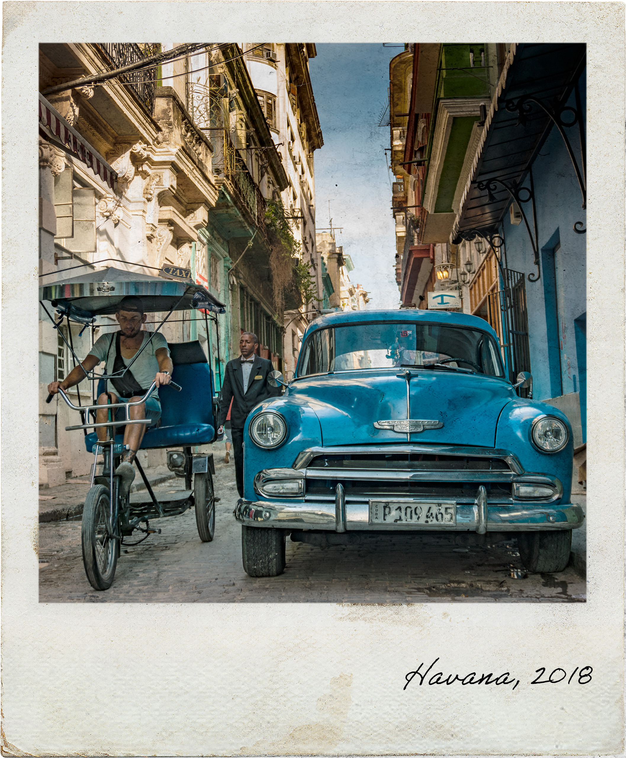Old car and bicitaxi in Havana Vieja